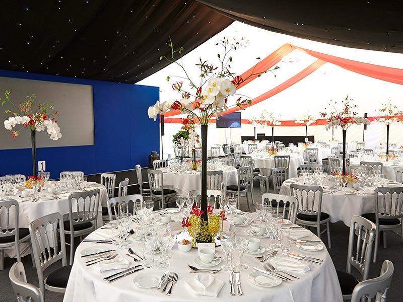 Interior of Corporate Marquee set up for dining